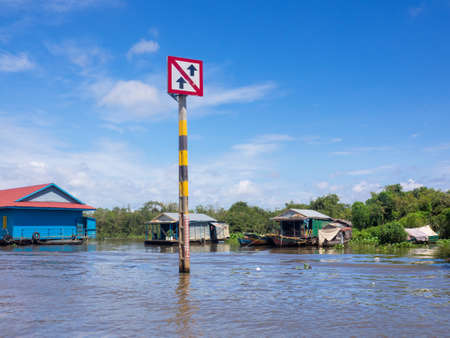 Boat traffic sign at Tonle Sap, Siem Reap, Cambodia, caution about the traffic in community district