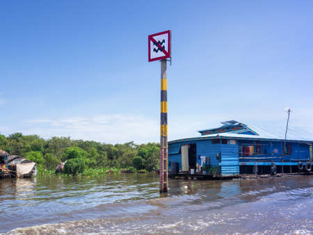 Boat traffic sign at Tonle Sap, Siem Reap, Cambodia, caution about not creating high wave in community district by controlling the speed of the boat