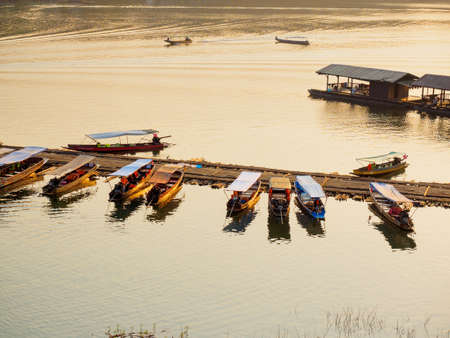 Sangkhlaburi - March 05, 2017: The small tourist boats docking at  the river in Sangkhlaburi District, Kanchanaburi Province, Thailand, in the early morning.