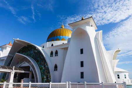 Melaka floating mosque or Masjid Selat Melaka in Melaka or Malacca, Malaysia, with blue sky