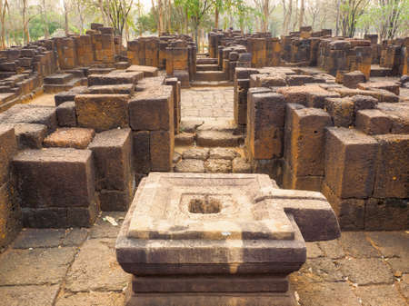 The stone yoni or female sex organ which is a basement of Shiva linga and stone columns inside the ancient Khmer-style temple in Mueang Singh historical park in Kanchanaburi Province, Thailand. 報道画像