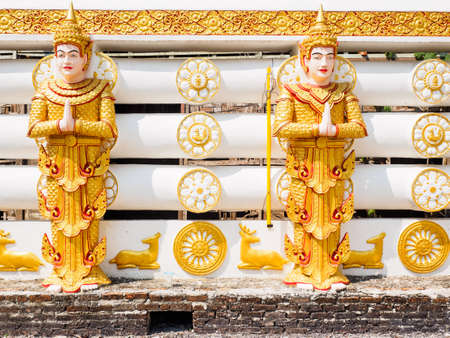 The statues of Deva or Hindu God at the wall of Wangwiwegaram temple in Sangkhlaburi District, Kanchanaburi Province, Thailand 写真素材