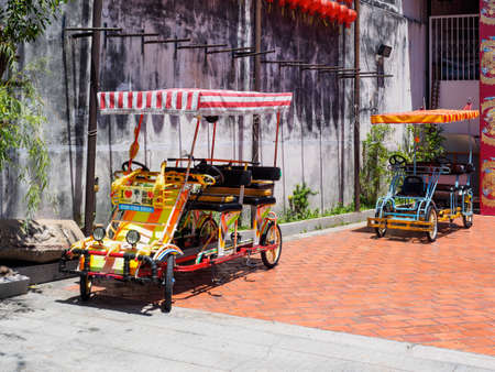 Penang,  Malaysia - April 24, 2017:  Colorful  quadricycles or surrey bikes for rental in the area of  UNESCO World Heritage site of George town, Penang, Malaysia. 報道画像