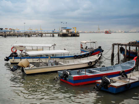 Penang,  Malaysia - April 24, 2017: Motorized Boats boat docking at Clan Jetty  or water villages  which are homes to various Chinese clan in George town, Penang, Malaysia. 報道画像
