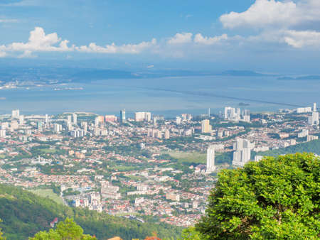 The scenery from Penang Hill, Penang, Malaysia, showing the city in the foreground and the sea and Penang bridge in the background. Stock Photo