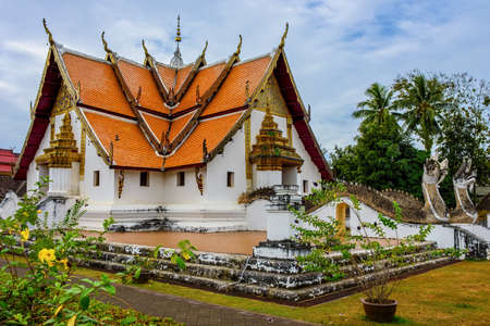 The beautiful building of Phu Mintr temple in Nan Province, Thailand, with blue sky
