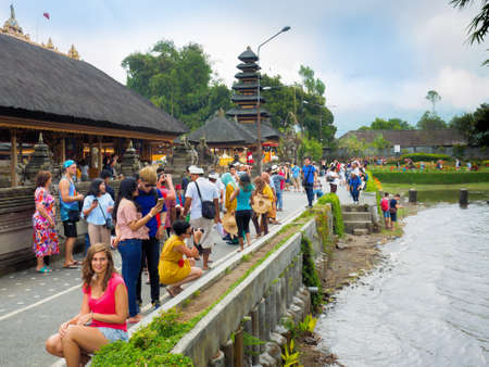 Bali, Indonesia - September 17, 2016: Tourists visiting Ulun Danu Beratan Temple, the Hindu temple in Tabanan Regency, Bali, Indonesia, which one of the tourist destination in Bali Island.