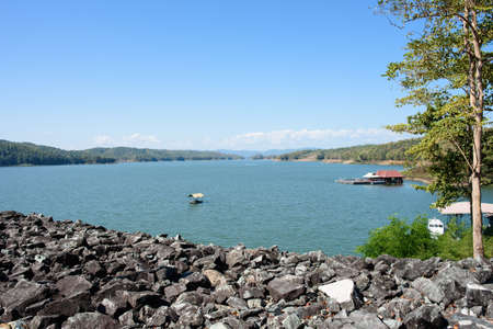 The scenery of Queen Sirikit Dam in Uttaradit Province, Thailand, with a boathouse is at the lake.