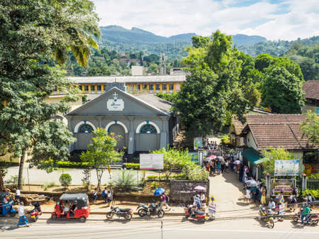 Kandy, Sri Lanka - November 8, 2017:  Parents waiting for their children at St. Johns College in Kandy city, after their children finish their day in school.