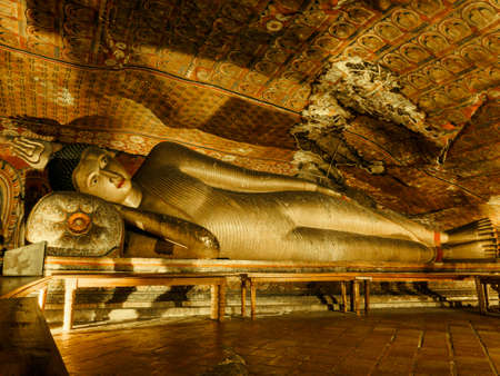 The statue of reclining Buddha at Dambulla Cave Temple, the cave temple  of Sri Lanka which is the UNESCO World Heritage Site at Dambulla city, Sri Lanka