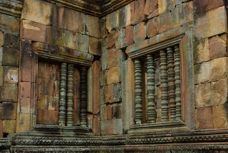 The ancient carved stone bar window of Prasat Muang Tam an ancient Khmer-style temple complex built in Buriram Province, Thailand, which is built in the 10th -11th century.