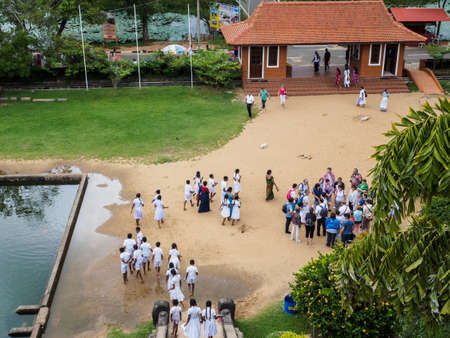 Anuradhapura, Sri Lanka - November 10, 2017: Sri Lankan students and Western tourists visiting Isurumuniya, the ancient temple which was built between 250 - 210 BC.