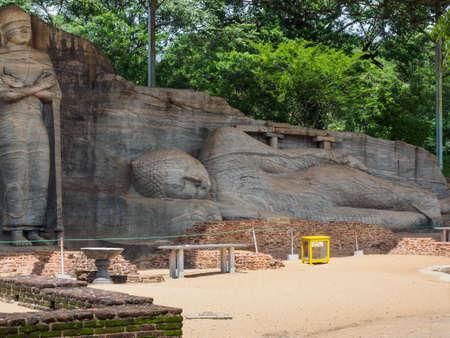 The ancient reclining Buddha image and the standing Buddha image at Gal Vihara, Polonnaruwa, Sri Lanka