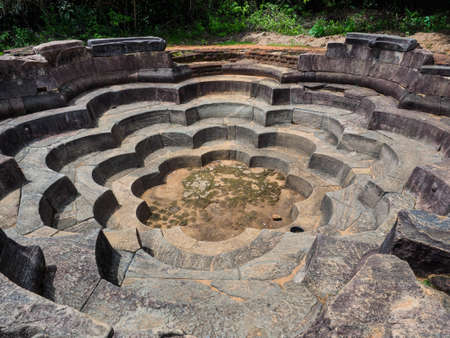 Lotus Pond or Nelum Pokuna in the ancient city Polonnaruwa, Sri Lanka, in a design of 8 petaled lotus flowers is believed to be used for ritual baths for the pilgrims.
