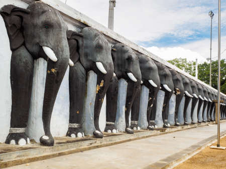 Row of elephant sculptures at the wall of  the Ruwanwelisaya stupa in Anuradhapura, Sri Lanka. 写真素材