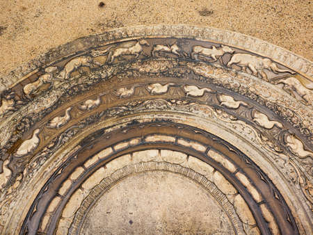 The artistic ancient moonstone in Anuradhapura ancient city which was built during 7-8 centuries. It is the carved semi-circular stone slab, placed at the bottom of staircases and entrances of the tem