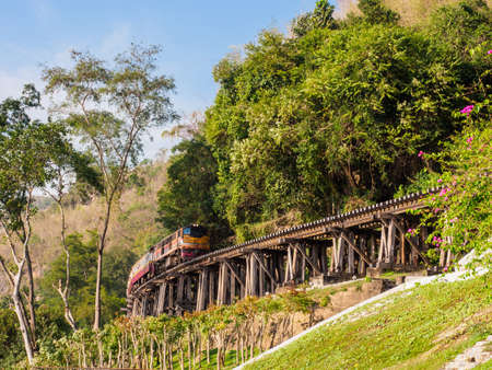 The train traveling along historic Death Railway which was built by the Allied prisoners of war under the captivity of Japanese army during the World War II.
