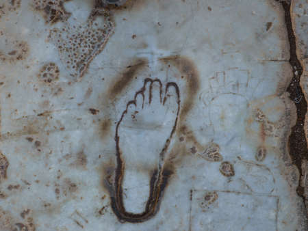 The engraved foot, the hand with money and the heart on the  road in Ancient Ephesus city in Turkey which  is believed to be an oldest advertisement for visiting  the nearby brothel.