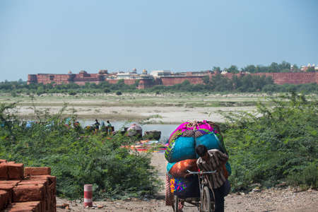 transported: Newly washed clothes being transported from the Yamuna river