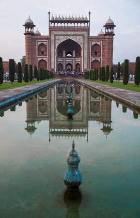 mausoleum: Center reflection pool reflecting Taj Mahal entrance during sunrise