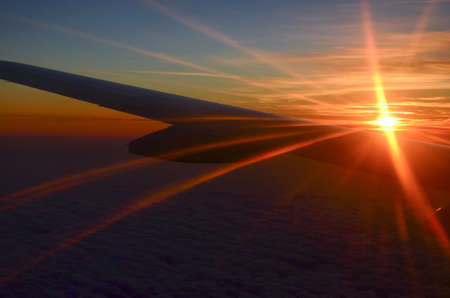 the sun rise on the horizon on a plane