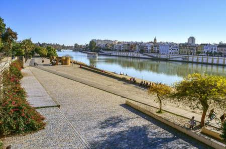 sunny walking afternoon in Guadalquivir river Foto de archivo