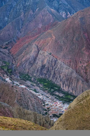 Stock photo of the Iruya village between colored hills and mountains valley. Salta, Argentina. Colorful landscape