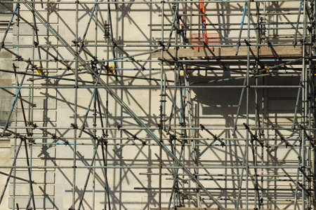 Sunlit Scaffolding with Cast Shadows on the Wall of a Portland Stone Building