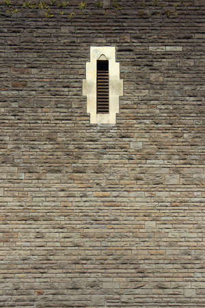 High Stone Wall with a Narrow Arrow Slit Style Window