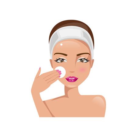 Ejemplo de una cara hermosa mujer de limpieza con un algodón