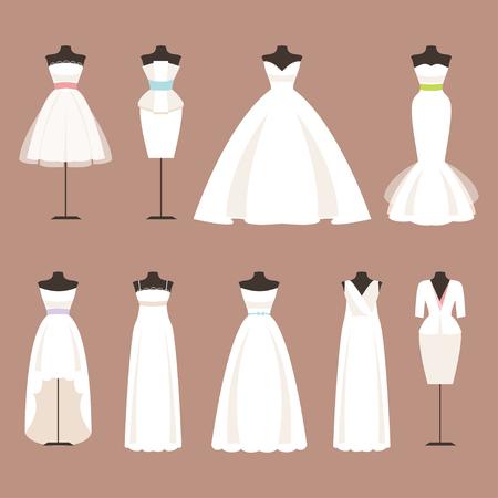 blanco: Diferentes estilos de vestidos de novia en un maniquí