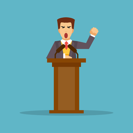 appeals: Talking and gesticulating a man stands behind a podium with microphones