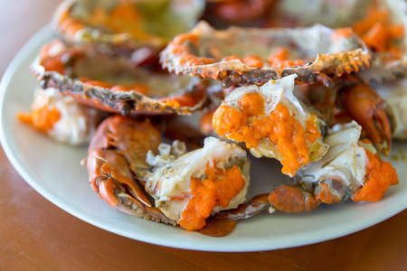 Boiled crab fresh and hot - delicious appetizer, steamed crab showing the delicious crab's eggs inside its shell