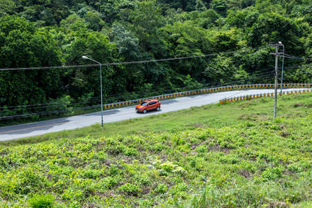 Driving down through the hills from San dam of Kaeng Krachan dam Stok Fotoğraf
