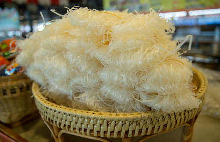 dried thin rice noodles in the basket at the market
