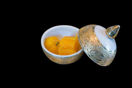 Thai desert as egg yoke fudge balls (thong yip) and deletable imitation fruits (Luk Chup) in mini thai Porcelain cup Reklamní fotografie
