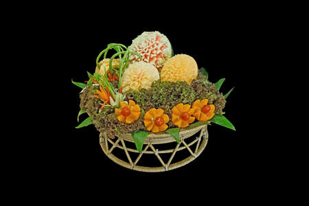 Mix Fruit and Vegetable carved shape beautiful flowers of thailand, isolated on black background Stock Photo