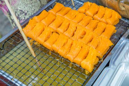 Foi Tong (Shredded Egg Yolk Tart) , focus selective. Фото со стока
