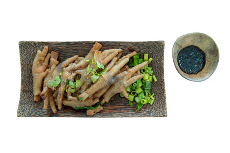 Thai food,chicken foot serve in Coconut shell plate, die cut on white background