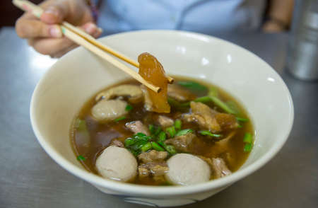 Close up Chinese clear soup and meatball and vegetables
