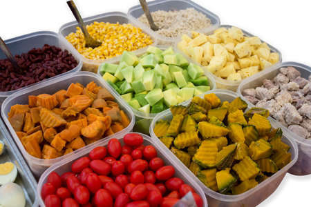Salads, mixed fruits, foods that contain many kinds in plastic cups. On a white background,