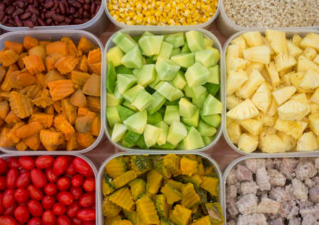 Salads, mixed fruits, foods that contain many kinds in plastic cups, top view.