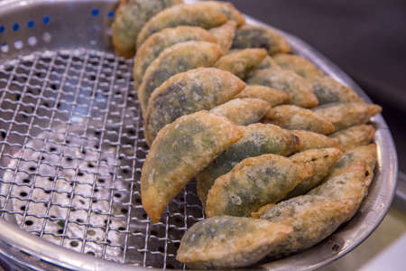 Chives dumpling(kuicheai) with oil in a pan at the local market