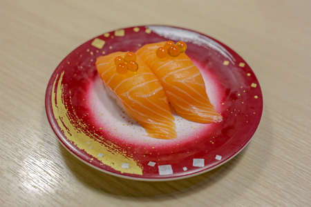 Sushi salmon with egg shrimp on cream table, focus selective