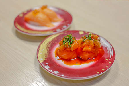 Salmon roll with egg shrimp on cream table, focus selective 写真素材
