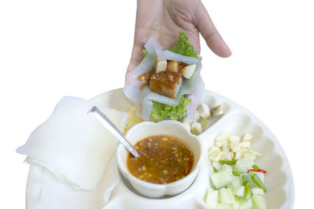 Vietnamese Meatball wrap (Nam Neung) ground pork, wrapped in rice paper, generous platter eat with sweet sauce.