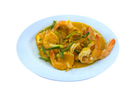Top view of Stir Fried Shrimp with Salted Eggs on white isolated.