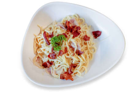 Top view of Spaghetti carbonara with cheese and crispy bacon, focus selective.