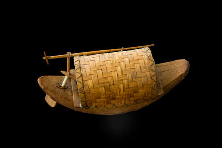 Small boats made of coconut shell local handicraft available in the market, focus selective