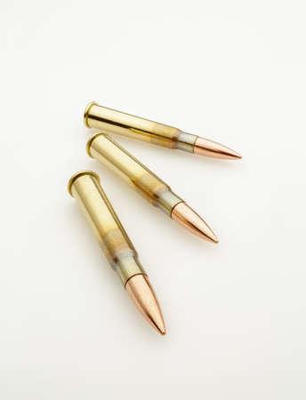 Large Caliber Bullets Catridges Isolated on White Wide Angle Stock Photo